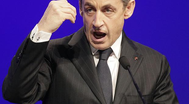 Nicolas Sarkozy denies allegations he was offered campaign financing from Muammar Gaddafi for his first presidential bid (AP)