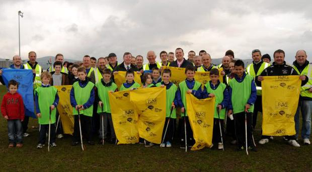 The clean-up team gets ready to tackle the |rubbish at Lisburn Distillery FC's car park