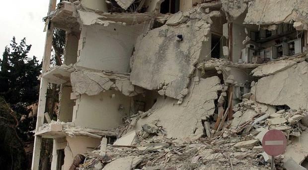 One of the buildings damaged when two bombs exploded near a military compound in Idlib, Syria (AP)