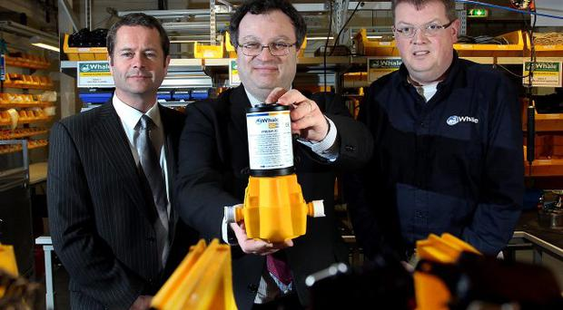 Employment and Learning Minister, Dr Stephen Farry (centre) with David McComb Operations manager at Parity Solutions Limited (left) and Patrick Hirst chief executive Whale Pumps