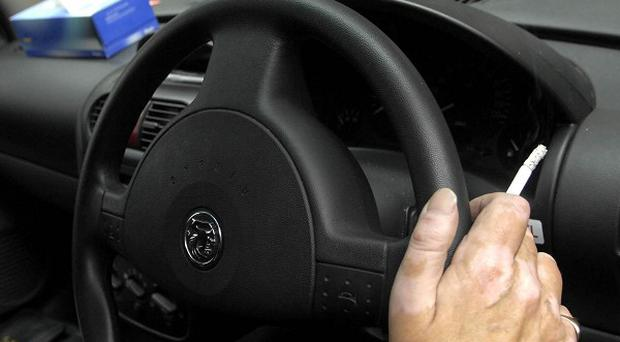 Statistics show some smokers are illegally lighting up behind the wheel of work vehicles