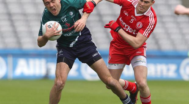 Tyrone's Cathal McCarron (right) takes on John Doyle of Kildare
