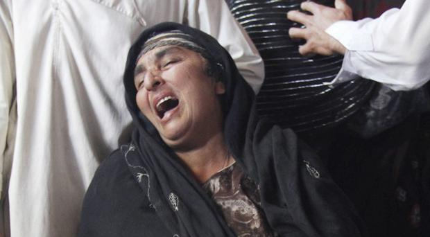An Afghan woman mourns over the body of her son, Abdul Satar, who was allegedly killed in an Afghan-led operation in Laghman, east of Kabul (AP)