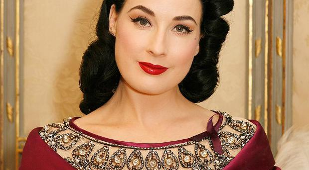 Dita Von Teese counts Simon Cowell among her fans