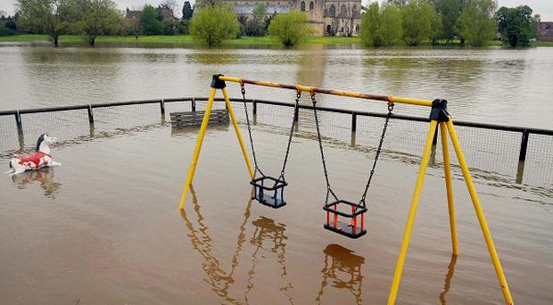 Flooding in a playground near Tewkesbury Abbey in Gloucestershire