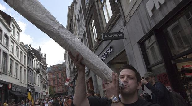 A demonstrator protests against the new marijuana buying policy in Maastricht, Netherlands (AP)