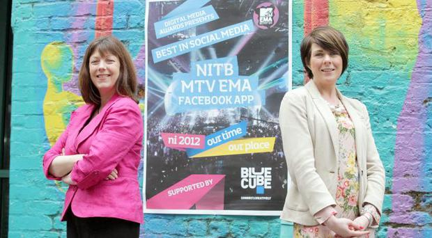 The Northern Ireland Tourist Board's (NITB) destination marketing and PR manager Ruth Burns and Blue Cube's managing director Dana-Marie McCracken celebrate being awarded the Best in Social Media at the Digital Media Awards 2012. NITB picked up the award with partner digital advertising agency Blue Cube for their MTV EMA Facebook App campaign