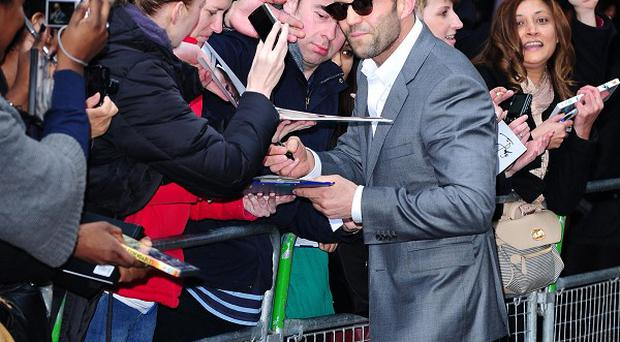 Jason Statham meets the public as he arrives at the premiere of his new film, Safe