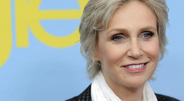 Jane Lynch is enjoying discovering the softer side of Sue Sylvester