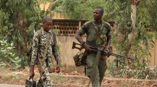 Soldiers loyal to junta chief Capt Amadou Sanogo patrol in Bamako, Mali (AP)