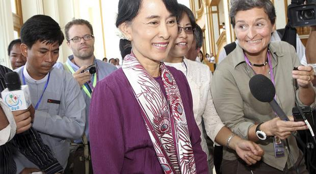Burma pro-democracy icon Aung San Suu Kyi arrives at parliament to attend a regular session of the Lower House in Naypyitaw (AP)