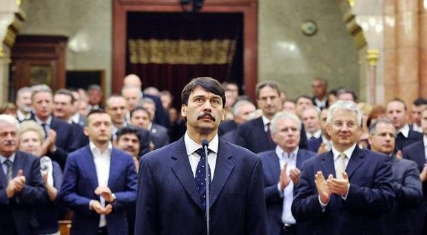 Janos Ader is sworn in as President of the Republic of Hungary in Budapest (AP)