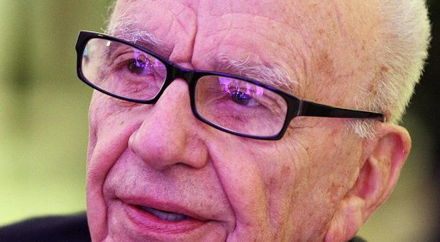 Ruper Murdoch has been backed by the board of directors at News Corp