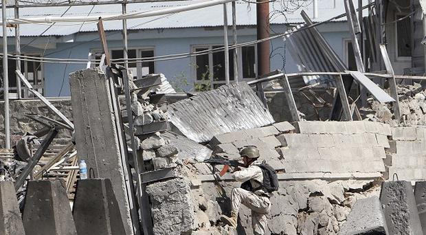 An Afghan police special force member mans a compound at the scene of militants attack, in Kabul, Afghanistan (AP Photo)