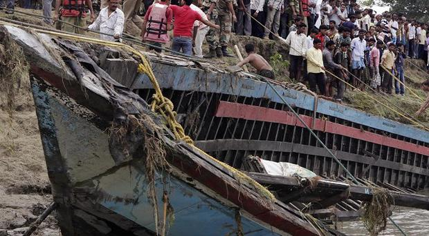 Rescuers pull the wreckage of a ferry from the Brahmaputra River (AP)