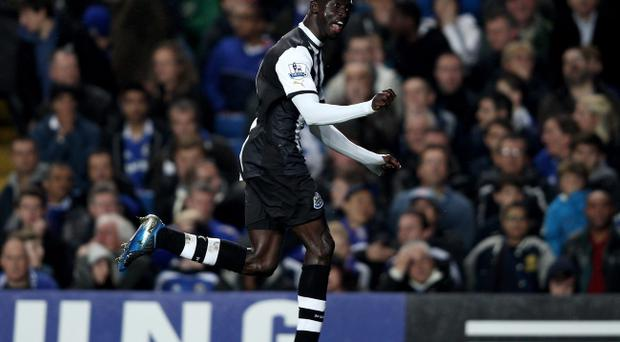 LONDON, ENGLAND - MAY 02: Papiss Cisse of Newcastle celebrates after scoring his team's second goal during the Barclays Premier League match between Chelsea and Newcastle United at Stamford Bridge on May 2, 2012 in London, England. (Photo by Ian Walton/Getty Images)