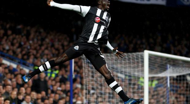 LONDON, ENGLAND - MAY 02: Papiss Cisse of Newcastle celebrates after scoring the opening goal during the Barclays Premier League match between Chelsea and Newcastle United at Stamford Bridge on May 2, 2012 in London, England. (Photo by Julian Finney/Getty Images)