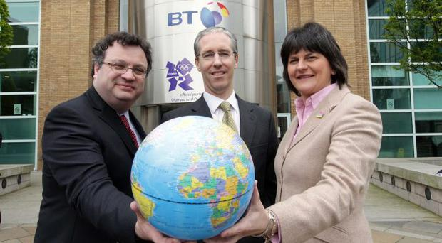Enterprise Minister Arlene Foster and Employment and Learning Minister Stephen Farry with BT Northern Ireland chief executive Colm O'Neill (centre) at the new jobs announcement in Belfast