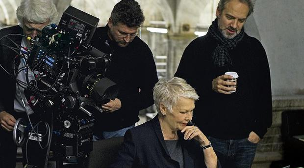 Sam Mendes says he wanted to make good use of Dame Judi Dench's acting skills in Skyfall