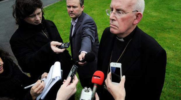 PACEMAKER BELFAST 2/5/12 Cardinal Sean Brady exit's his home to come and speak to the media regarding his part in an eledged cover up of child abuse in the 1970's. picture Mark Marlow/pacemaker press.