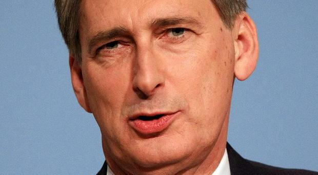 Philip Hammond said those who borrowed money during the economic boom should also accept responsibility for their role in the financial crash