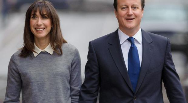 Prime Minister David Cameron and his wife Samantha arrive at the polling station in Methodist Central Hall, Westminster, London