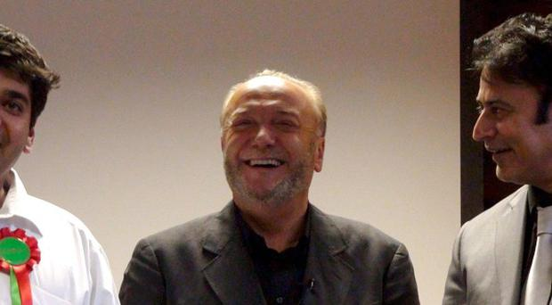 Respect Party leader George Galloway with supporters at the party's Bradford HQ