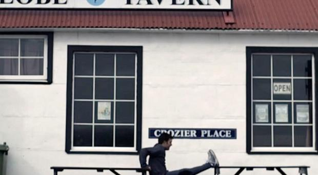 Argentine Olympic hockey player Fernando Zylberberg exercises in front of the Globe Tavern in Stanley (AP Photo/Argentine Presidential Office)