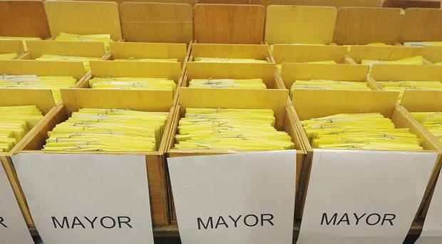 Ballot papers are packed away after counting in the Bristol mayoral referendum at Ashton Gate Stadium in Bristol