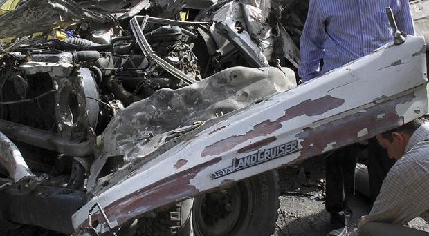 An explosive device detonated under a military vehicle in Damascus (AP)