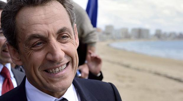 France's incumbent president Nicolas Sarkozy strolls along the sea front after his last campaign meeting in Les Sables-d'Olonne, western France (AP)