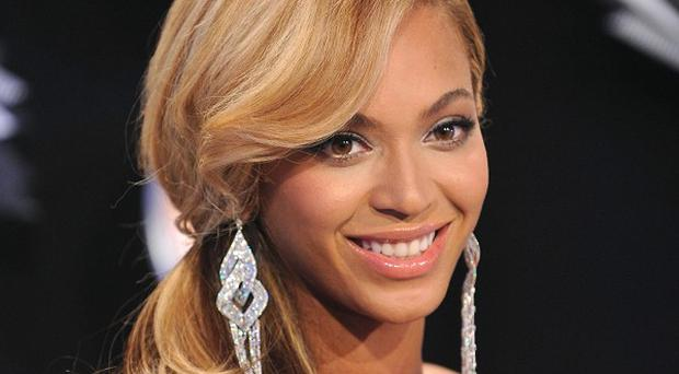 Beyonce will collect an award for an article in Essence magazine