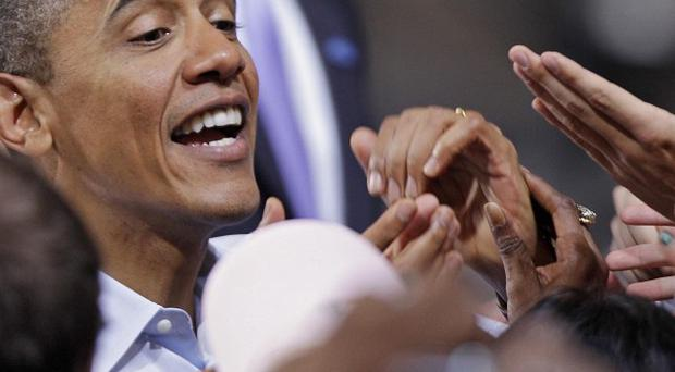 US President Barack Obama greets supporters after a campaign rally at Ohio State University in Columbus (AP)