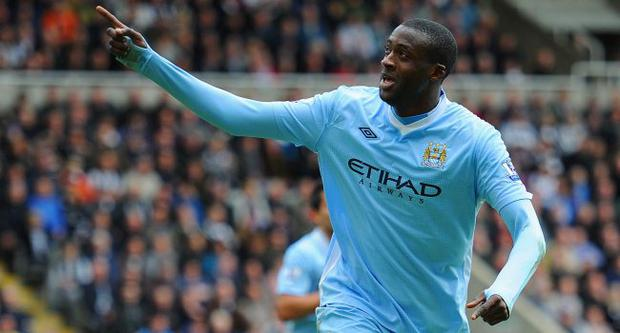 Yaya Toure of Manchester City celebrates scoring to make it 2-0against Newcastle