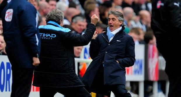 Manchester City manager Roberto Mancini celebrates the 2nd goal against Newcastle
