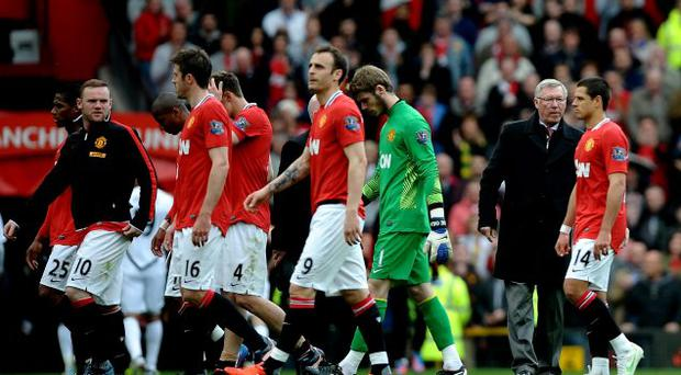 Wayne Rooney of Manchester United and his team mates walk around the pitch with Manchester United Manager Sir Alex Ferguson at the end of the Barclays Premier League match between Manchester United and Swansea City