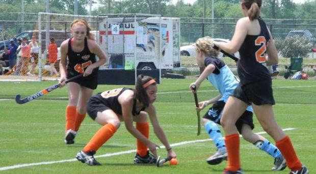 Keeling Pilaro, 13, center right, plays offence as as a member of the East End Field Hockey club in New York. Pilaro