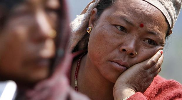 A relative of a missing person mourns at the scene of a flash flood at Kharapani village of Kaski district, Nepal (AP)