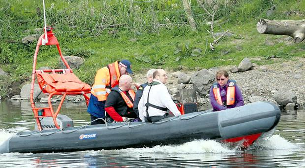 Rescue services and two witnesses during the search for Owen McKeown's body