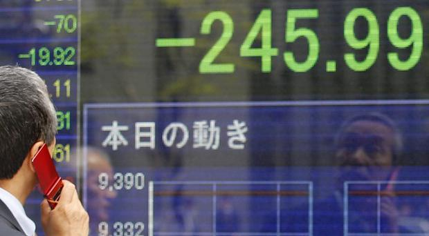 Japan's Nikkei plunged more than two per cent after elections in Greece and France