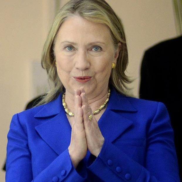 Hillary Clinton gestures with a traditional Indian 'namaste' before a meeting in Kolkata (AP)