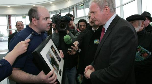 In the spotlight: Martin McGuinness, challenged by an IRA victim's son during the Irish presidential election