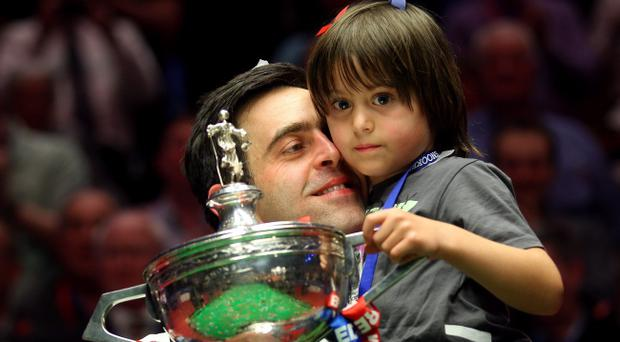 SHEFFIELD, ENGLAND - MAY 07: Ronnie O'Sullivan of England poses with his son Ronnie after beating Allister Carter of England in the final of the Betfred.com World Snooker Championship at the Crucible Theatre on May 7, 2012 in Sheffield, England. (Photo by Warren Little/Getty Images)