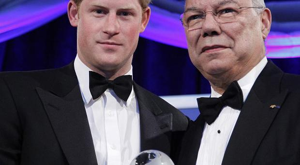 Prince Harry is presented the Atlantic Council's Distinguished Humanitarian Leadership award by former US Secretary of State Colin Powell (AP)
