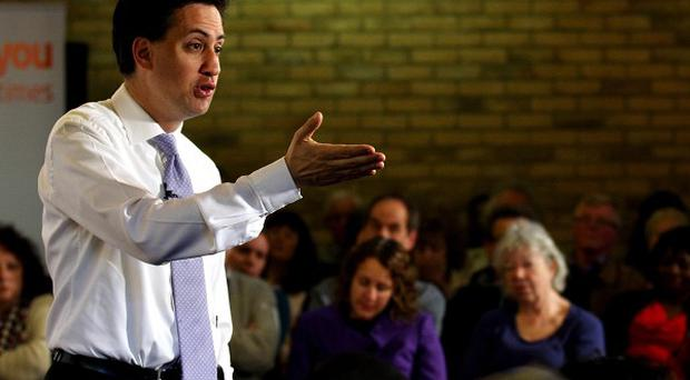 Labour leader Ed Miliband speaks during a question and answer session at Moot House in Harlow, Essex