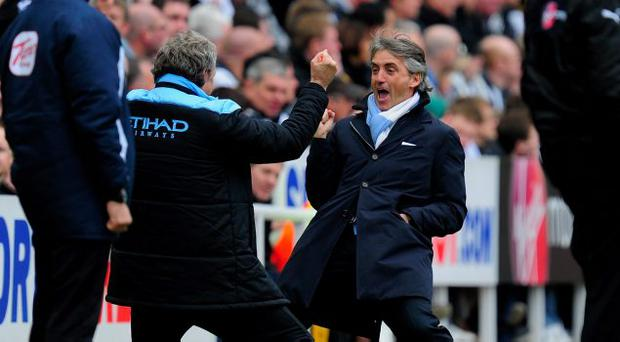 Roberto Mancini's Manchester City are hot favourites to win the Premier League title on Sunday