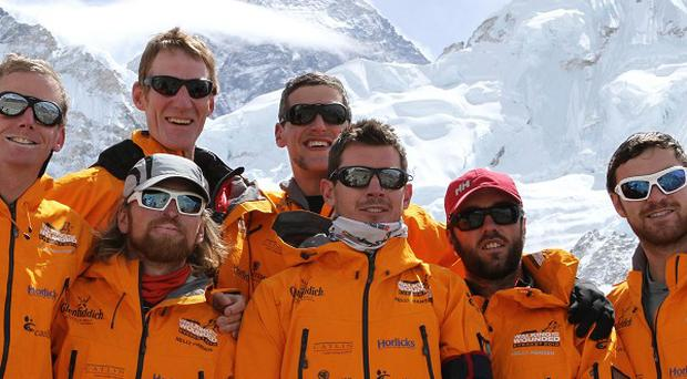 The Walking With The Wounded team has been thwarted in their Everest bid by unseasonably warm weather