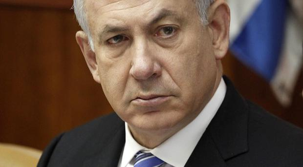 Benjamin Netanyahu reached an agreement with the Kadima opposition party for a unity governmen (AP)
