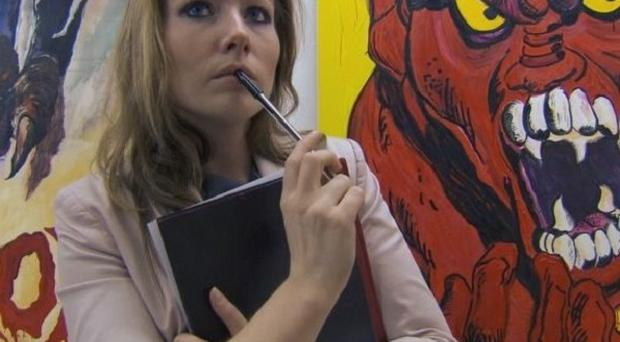 Apprentice contestant Laura contemplates the street art she is trying to sell