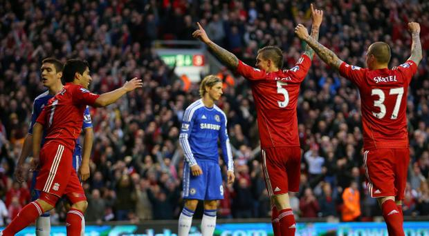 Daniel Agger of Liverpool celebrates scoring their third goal with Luis Suarez and Martin Skrtel of Liverpool during the Barclays Premier League match between Liverpool and Chelsea at Anfield on May 8, 2012